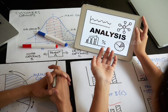 Discussing charts and graphs - Stock Photo - Images