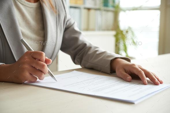 Signing document - Stock Photo - Images
