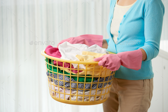 Young Woman Doing Laundry - Stock Photo - Images