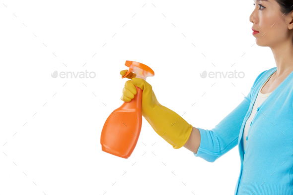Pretty Woman Using Spray Cleaner - Stock Photo - Images