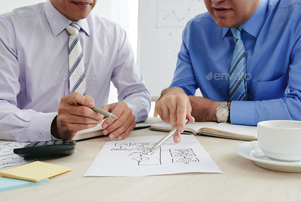 Discussing business chart - Stock Photo - Images