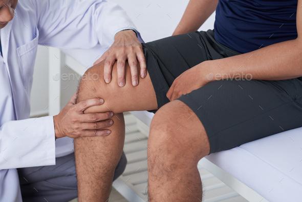 Examining knee - Stock Photo - Images