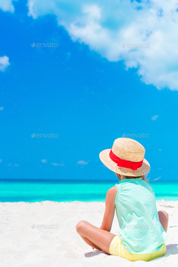 Little adorable kid in hat at the beach on the seashore - Stock Photo - Images