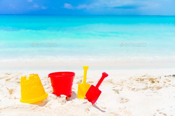 Kid's beach toys on white sandy beach background the sea - Stock Photo - Images
