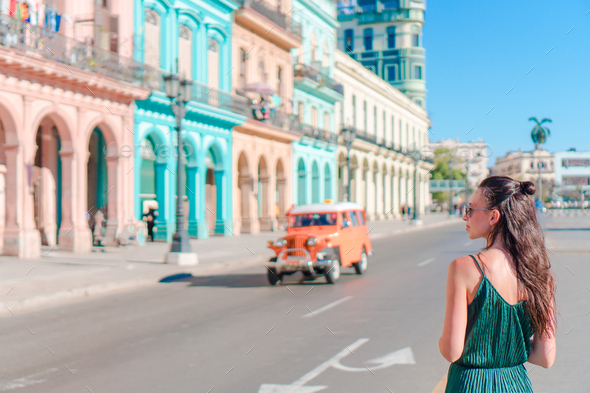 Happy woman in popular area in old Havana, Cuba. Young girl traveler background colorful houses - Stock Photo - Images