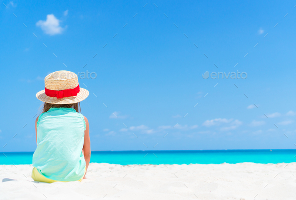 Little girl in hat at the beach during caribbean vacation - Stock Photo - Images