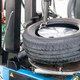 Series of worker removing tire from rim with removal machinery - PhotoDune Item for Sale