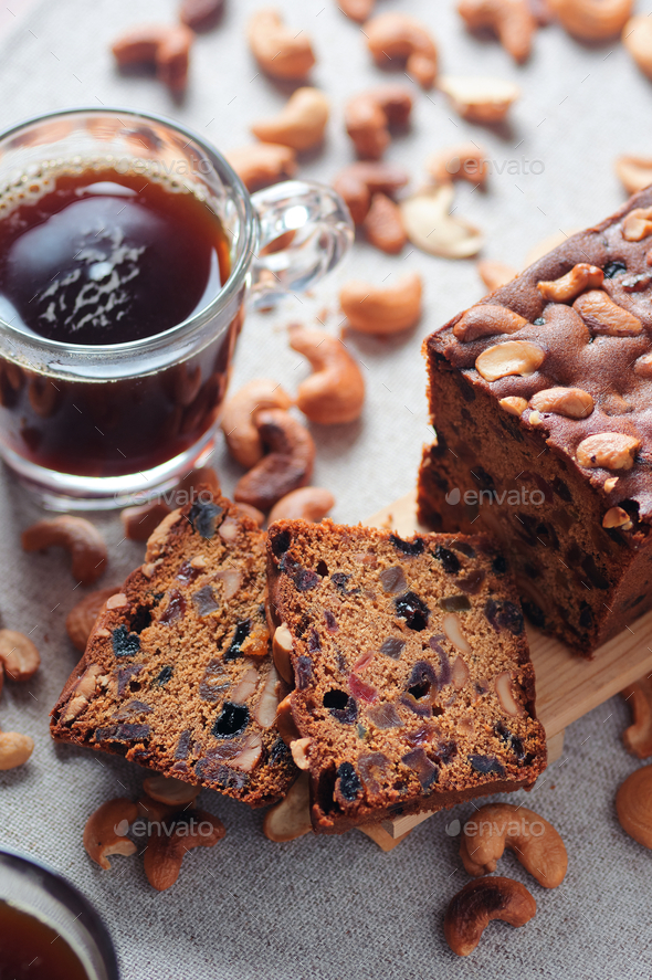 fruit cake white a cup of black coffee - Stock Photo - Images