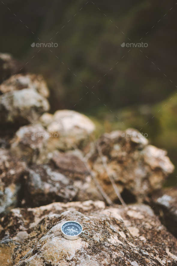 Navigation concept - Analogical compass laying on the rocky stone during trekking route in mountains - Stock Photo - Images