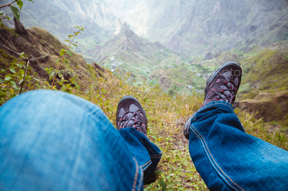 Traveler hiking boots over impressive verdant Xo-Xo valley with mountain peaks, rugged cliffs on - Stock Photo - Images
