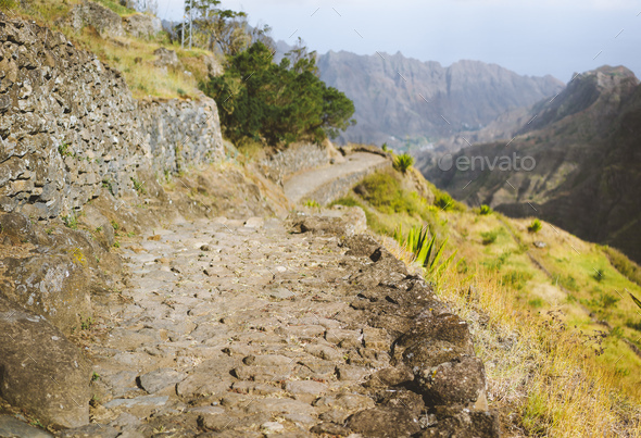 Typical trekking trail on Santo Antao, leads between huge rocks down to the Coculi valley. Cape - Stock Photo - Images