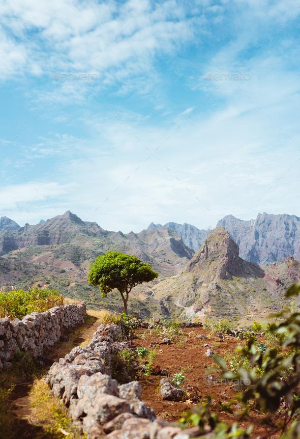 Hiking trail leading through arid rocky terrain towards Caculli village on Santo Antao Cape Verde - Stock Photo - Images