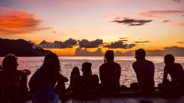 Travelers, Divers chilling at the Pier on Sunset, Kri Island. Raja Ampat, Indonesia, West Papua - Stock Photo - Images