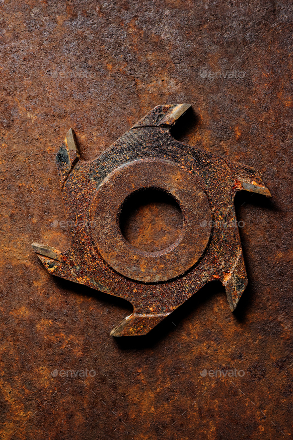 Old milling cutter on rusty metal background - Stock Photo - Images