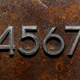 Row of metal cyrillic digits on a rusty background - PhotoDune Item for Sale