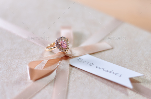 Pink diamond ring on a gift box - Stock Photo - Images