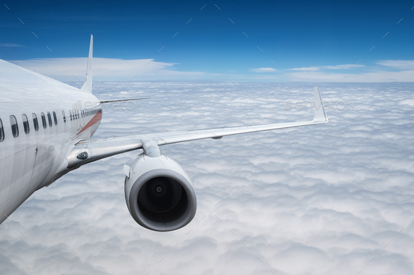 airplane above the clouds - Stock Photo - Images