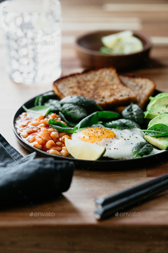 Healthy breakfast or lunch at home or cafe with fried egg - Stock Photo - Images