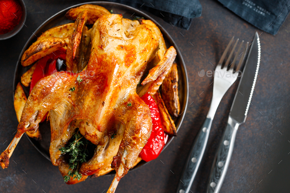 Roasted guinea fowl with herbs and olive oil - Stock Photo - Images
