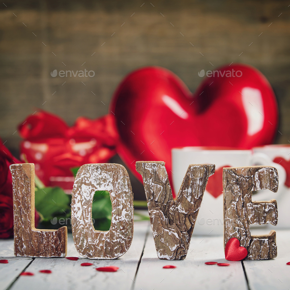 Valentine's Day concept. Love wooden letters on rustic background - Stock Photo - Images