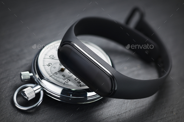 Stopwatch and fitness tracker. Sports training concept - Stock Photo - Images