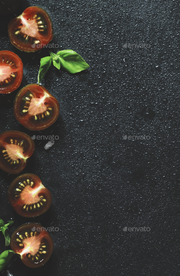 black and red cherry tomatoes and green basil - Stock Photo - Images