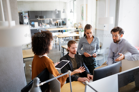 Creative managers crew working with new startup project in office. Team brainstorming - Stock Photo - Images