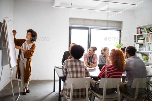 Group of young business people and designers.They working on new project.Startup concept - Stock Photo - Images