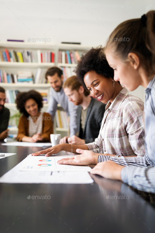 Business people, architects having discussion and working in office - Stock Photo - Images