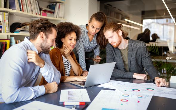 Group of business people collaborating on project in office - Stock Photo - Images