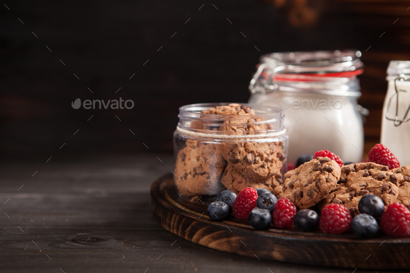 Fresh milk with delicious and freshly baked oatmel chocolate biscuits - Stock Photo - Images