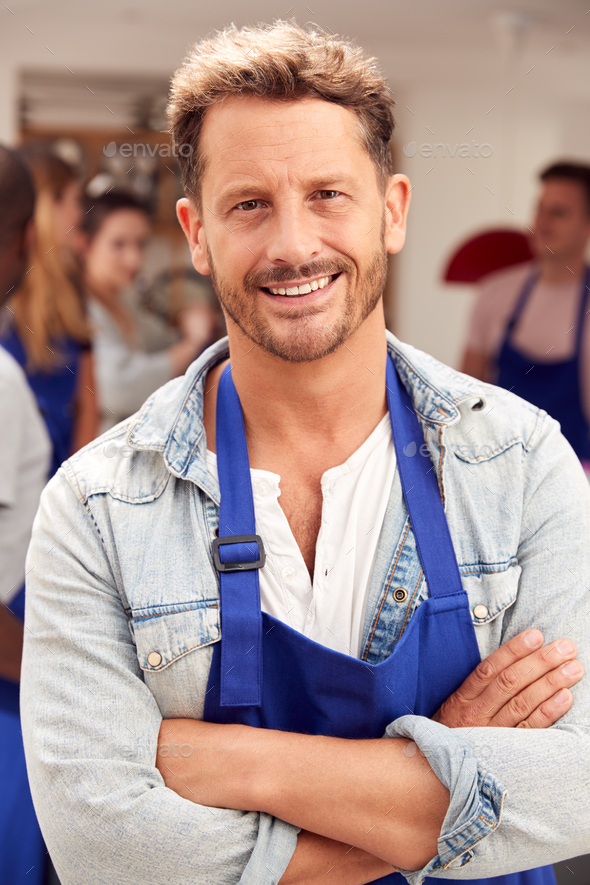 Portrait Of Smiling Mature Man Wearing Apron Taking Part In Cookery Class In Kitchen - Stock Photo - Images