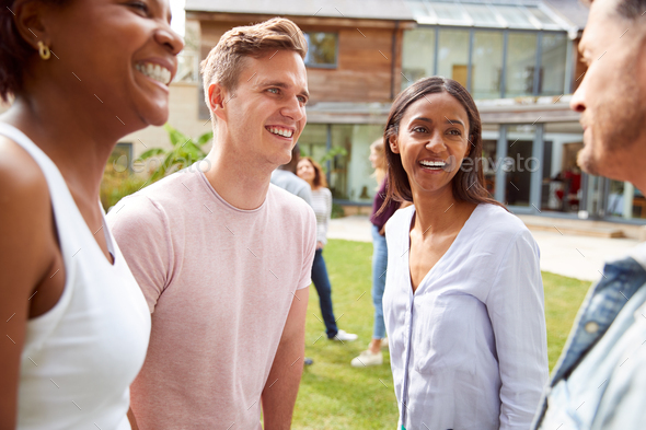 Group Of Multi-Cultural Friends Relaxing And Talking At Summer Garden Party Together - Stock Photo - Images