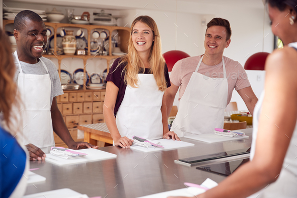 Male And Female Students Standing With Chopping Boards At Start Of Cookery Class In Kitchen - Stock Photo - Images