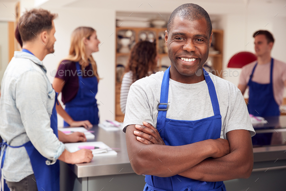 Portrait Of Smiling Man Wearing Apron Taking Part In Cookery Class In Kitchen - Stock Photo - Images
