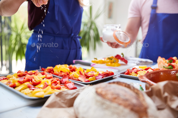 Close Up Of Salt Being Sprinkled On Tray Of Peppers In Kitchen Cookery Class - Stock Photo - Images