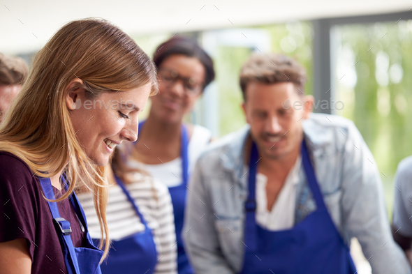 Students Watching Female Teacher Following Recipe In Cookery Class - Stock Photo - Images