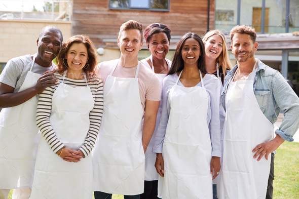 Group Portrait Of Men And Women Attending Cookery Class Relaxing Outdoors - Stock Photo - Images