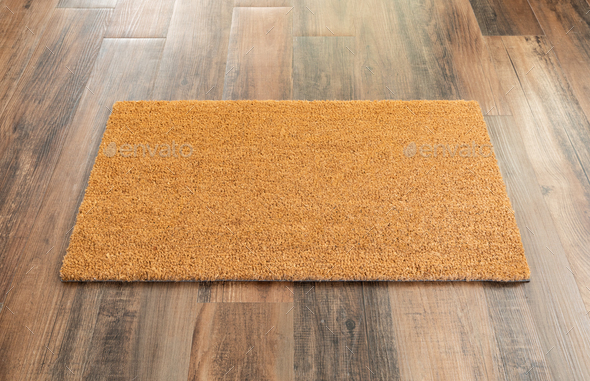 Blank Doormat On Wood Floor Background Ready For Your Own Text - Stock Photo - Images
