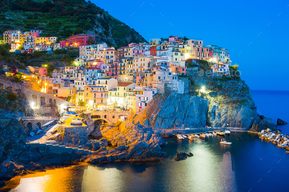 Stunning view of the beautiful and cozy village of Manarola in the Cinque Terre Reserve at sunset - Stock Photo - Images