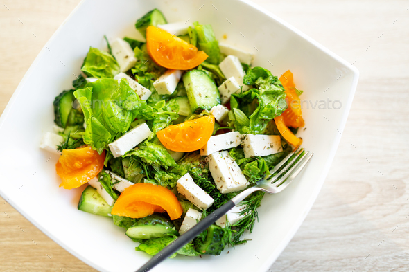 Fresh salad with cheese and tomatoes - Stock Photo - Images