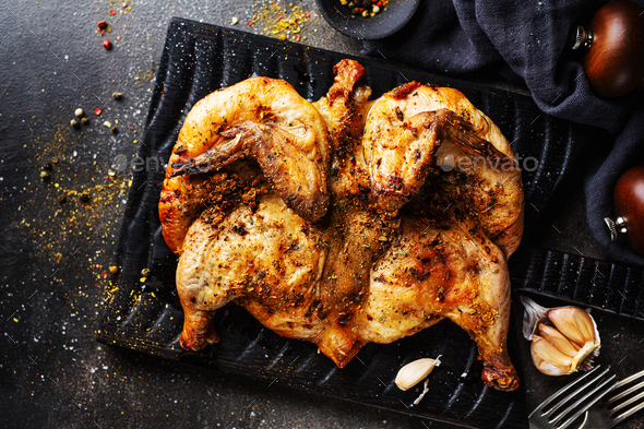 Baked chicken tabaka with spices - Stock Photo - Images