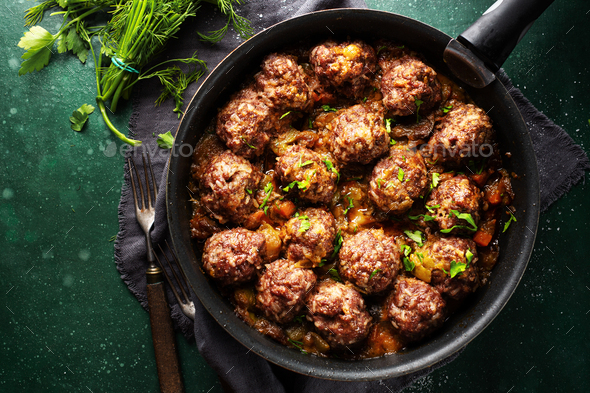 Fried meatballs with sauce on pan - Stock Photo - Images