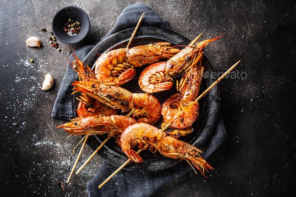 Tasty grilled shrimp skewers - Stock Photo - Images