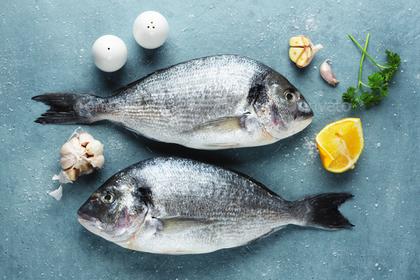 Fresh dorado fish with ingredients - Stock Photo - Images