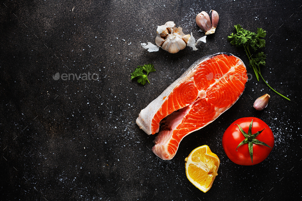 Raw fish steaks with ingredients - Stock Photo - Images