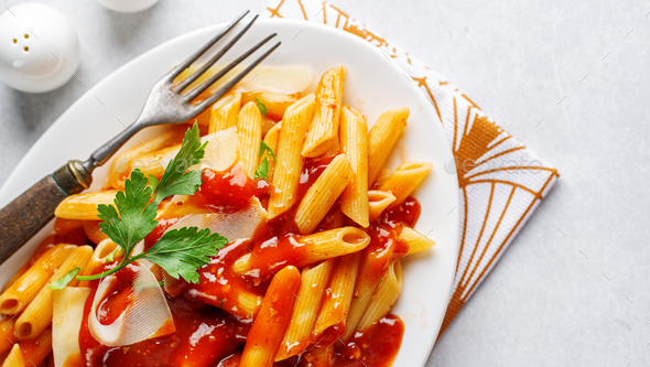 Penne pasta with tomato sauce - Stock Photo - Images