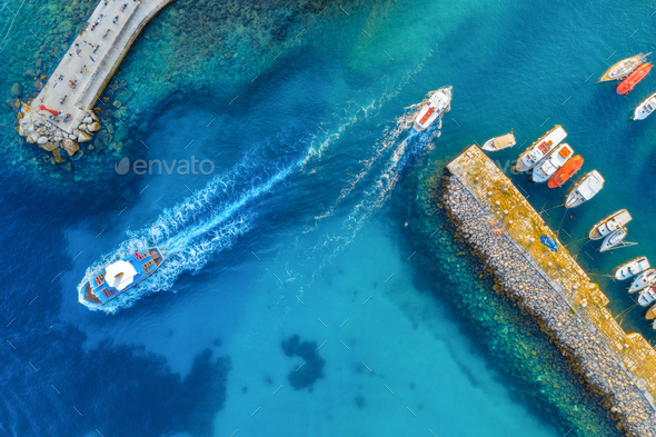 Aerial view of colorful boats and yachts in port in blue sea - Stock Photo - Images