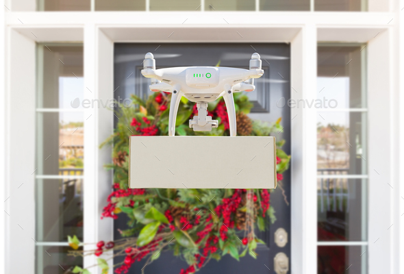 Drone Delivering Package to Christmas Decorated House Porch - Stock Photo - Images