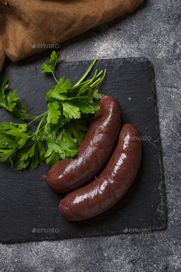 Homemade uncooked black pudding sausages - Stock Photo - Images